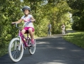 Girl riding a bicycle along a path