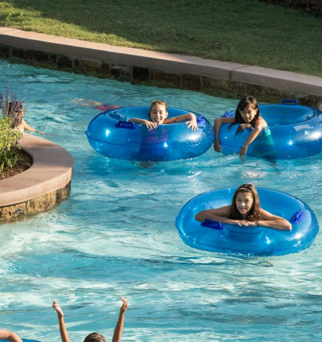 Kids riding tubes down the lazy river