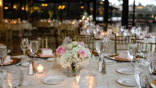 A bouquet of flowers sits at the center of a round table.