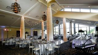A large wedding reception area with a dance floor.