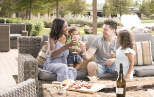 A family having lunch outside on a patio.