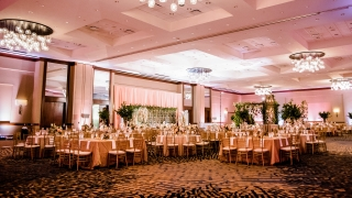 A large dining hall with stylish lights and high ceilings.
