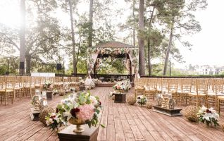 Chairs are lined next to an outdoor gazebo decorated for a wedding