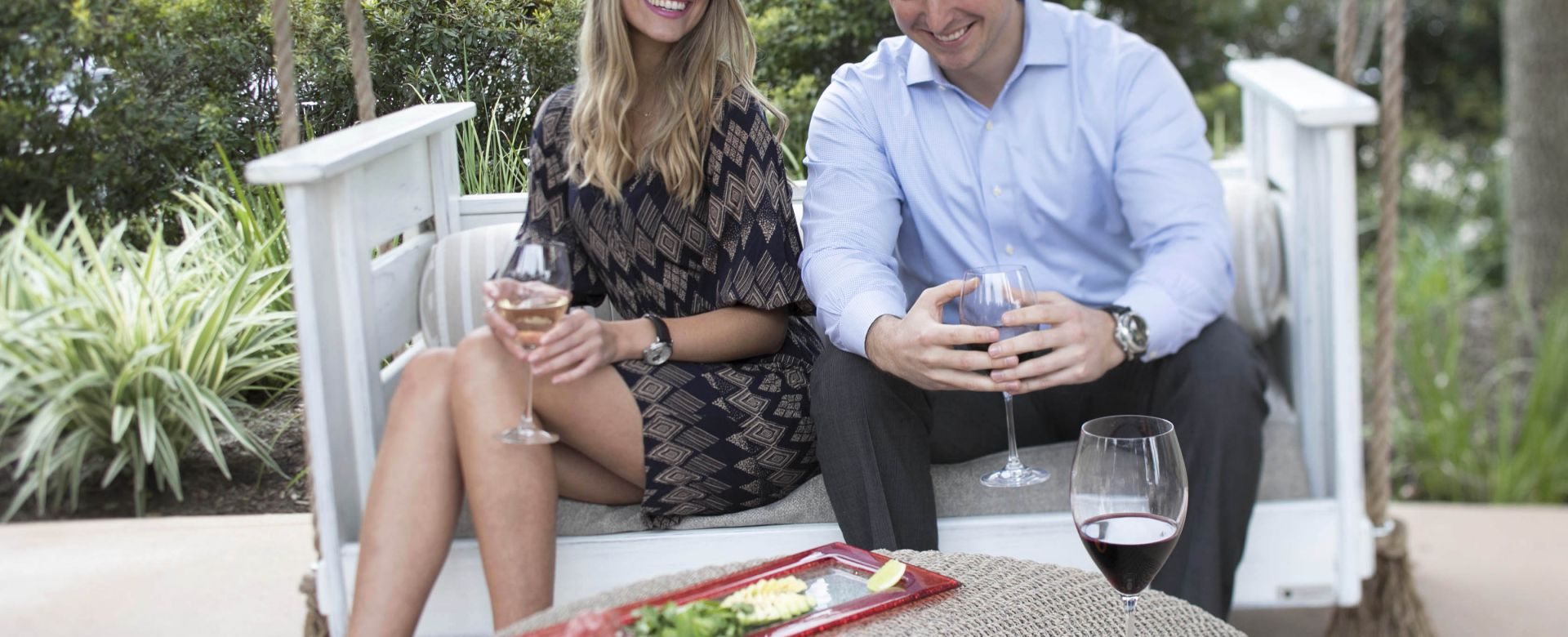 Couple enjoying food and drinks on Robard's Steakhouse patio.