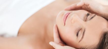 A woman relaxing during a spa facial.
