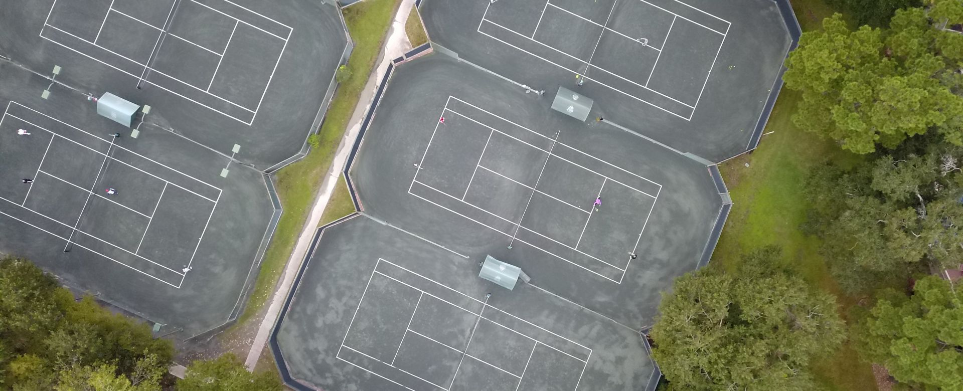Aerial view of clay tennis courts.