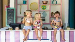 Three kids in swim gear eating Sweet Spot ice cream.
