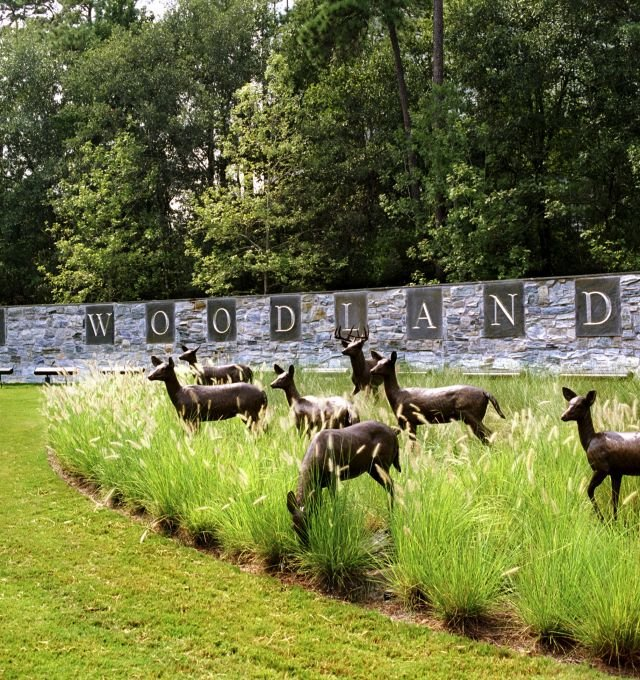 The Woodlands Resort sign and deer statues.