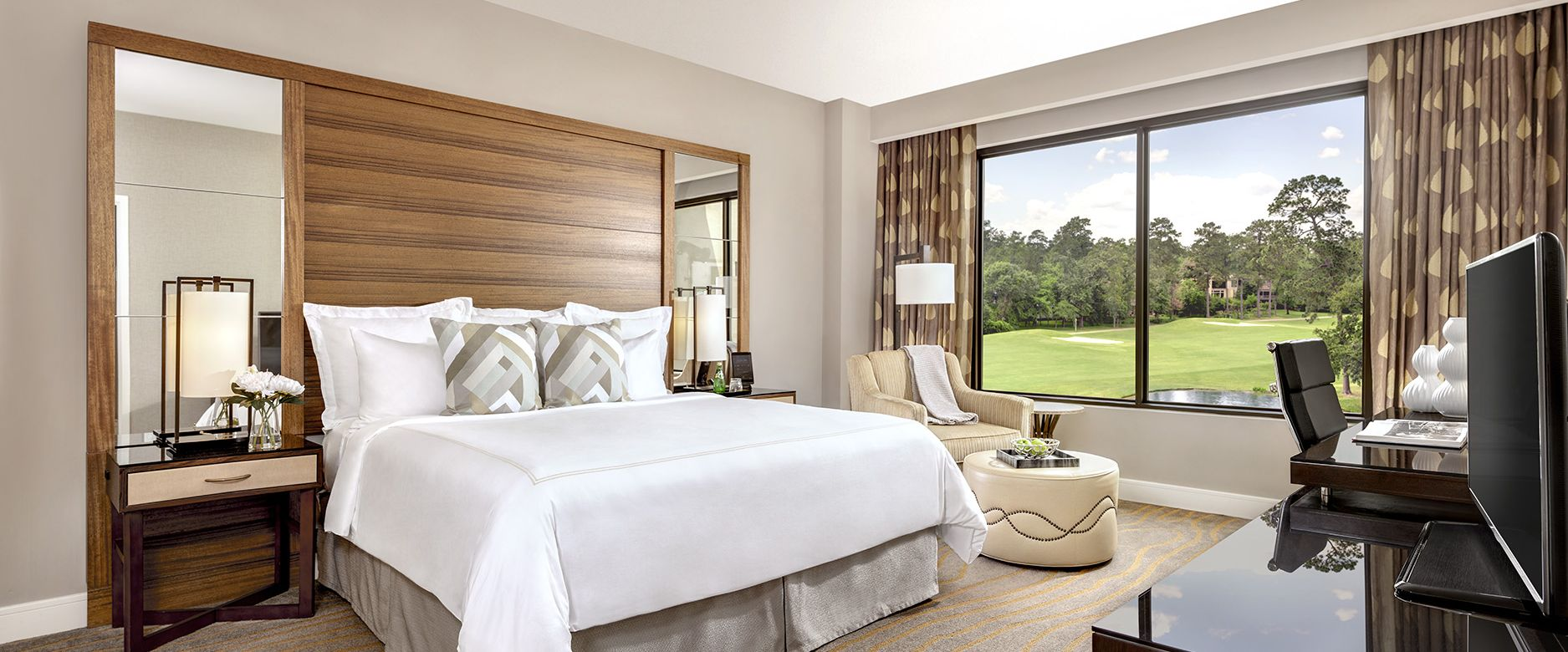 The Woodlands Suite Bedroom with a view of the golf course