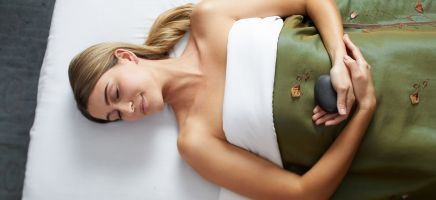 A woman lays down and relaxes after a massage.