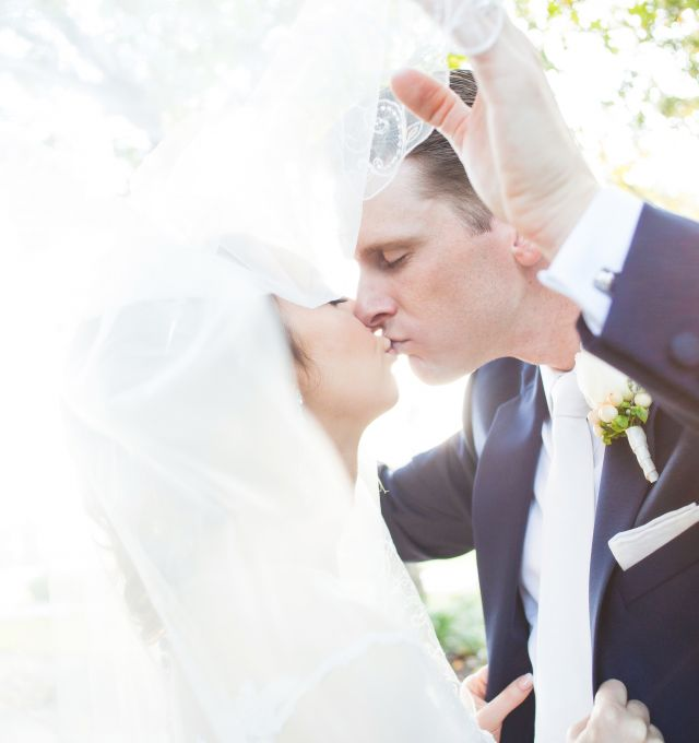 bride and groom kissing outside the woodlands resort