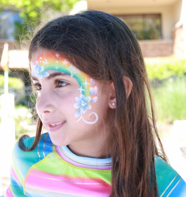 little girl with face paint